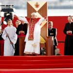 Pope Benedict XVI gestures to the thousands of pilgrims at Bangaroo