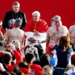 Pope Benedict XVI watches a group of aboriginal dancers