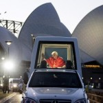 Pope Benedict XVI waves to pilgrims as he passes the Sydney Opera House