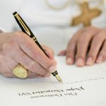 Pope signs visitors book at Admiralty House