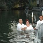 Pilgrims bath and baptise in The Jordan River Pic