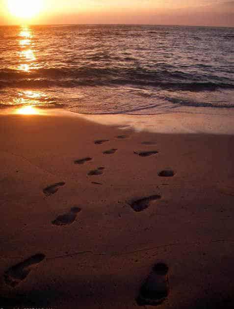 Footprints of God in sand