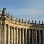 Bernini\'s monumental colonnade, topped with statues of saints
