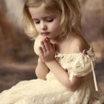 A little girl praying
