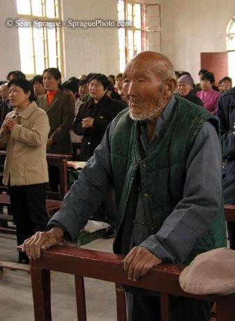Bored man in church