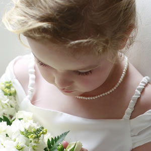 Little Girl and Necklace