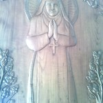 St Alphonsa carved on the door of Church