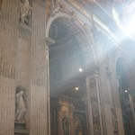 Sunlight beams into St. Peter\'s Basilica in Rome