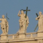 A statue of Jesus (center) overlooks St. Peter\'s Square in Rome