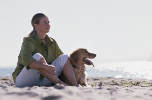 Lady with her dog on beach