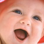 Happy Baby Wearing Hat