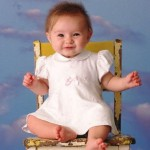 Smiling Infant Sitting on Chair