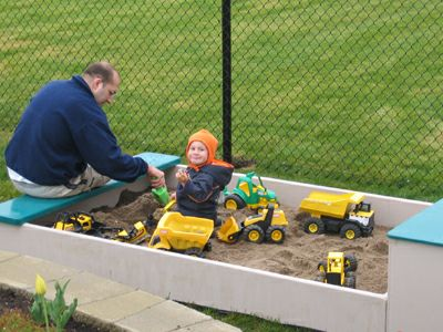sandbox helping father