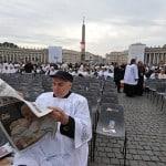 A priest reads a newspaper