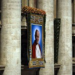 A tapestry of John Paul II on the facade