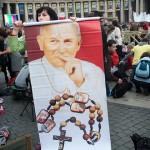 Pilgrim holds banner of John Paul II
