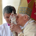 Pope Benedict XVI kisses the relic with blood